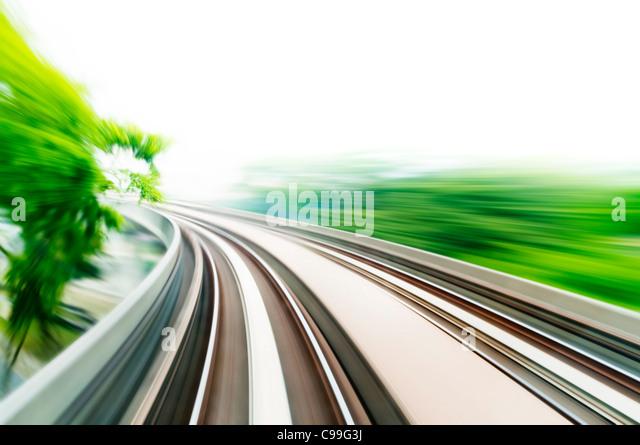 Motion blurred on speeding sky train. - Stock Image