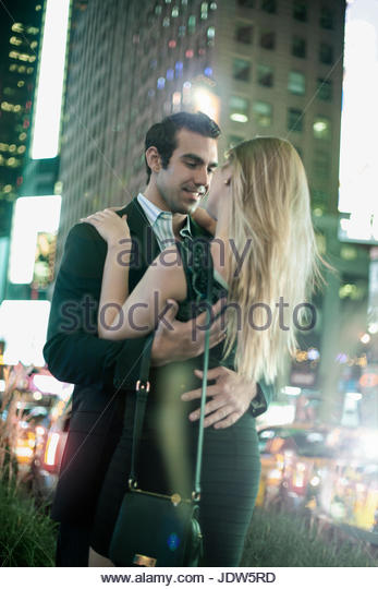 Romantic young couple on night out, New York City, USA - Stock-Bilder