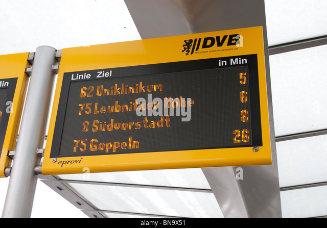 Information display at bus stop, showing times of arrival of next bus and tram, Dresden, Germany. - Stock Image