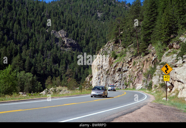 Automobiles travel along U.S. Route 34 through Big Thompson Canyon near Loveland, Colorado, USA. - Stock-Bilder