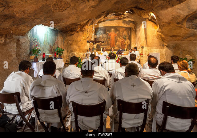 Franciscan monks at the mass in Grotto of Gethsemane in Jerusalem, Israel. - Stock Image