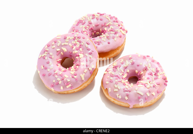Three ring doughnuts with pink icing - Stock Image