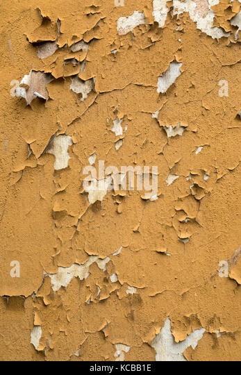 Old peeling paint on a wall in a derelict property in the city of Tallinn in Estonia. - Stock Image