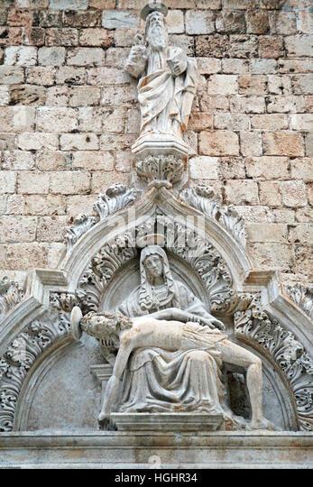 Pieta,sad Madonna,church portal in Dubrovnik,Croatia,Europe,1 - Stock Image
