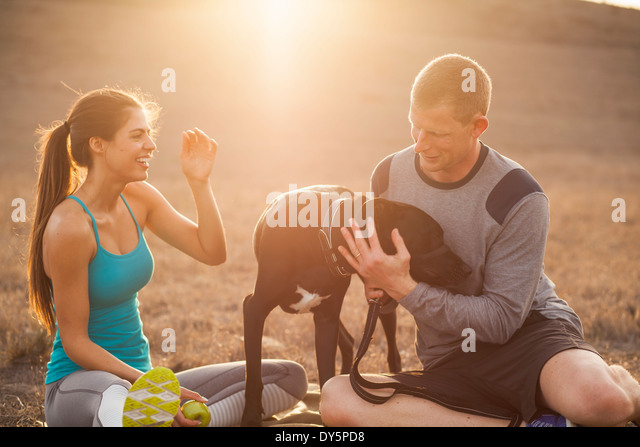 Couple with dog - Stock Image
