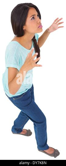 Angry young casual brunette gesturing - Stock Image