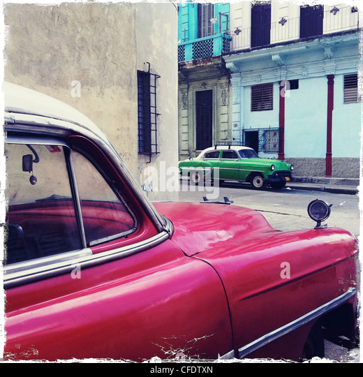 Street corner with red and green classic American cars, Havana Centro, Havana, Cuba, West Indies, Central America - Stock Image