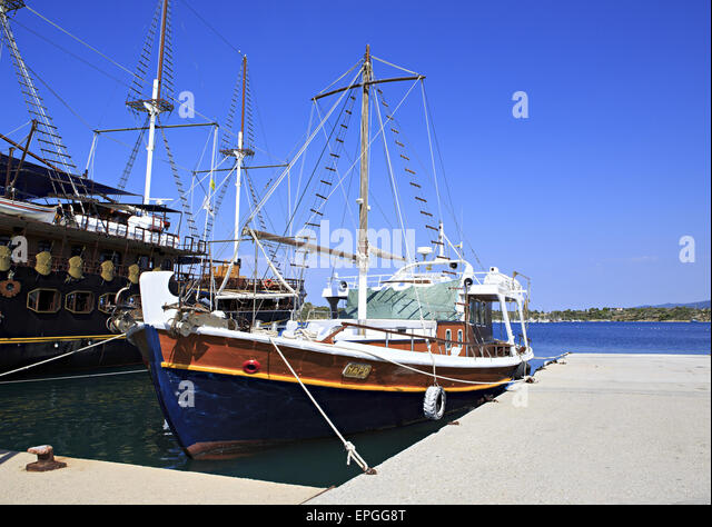 Ships in the harbor of Ormos Panagias - Stock Image