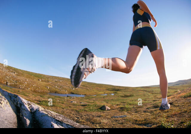 A female jogger. - Stock Image