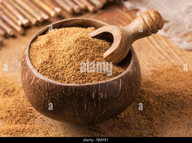 Coconut palm sugar in a bowl - Stock Image