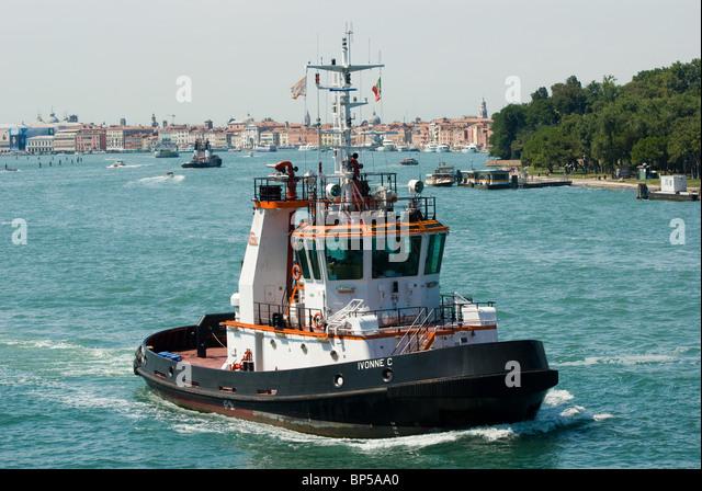 Tugboat on Canale della Giudecca, the approach to Venice, Italy near Lido di Venezia.. - Stock Image