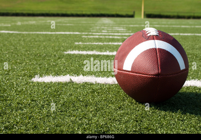 Closeup of American football on field. - Stock Image