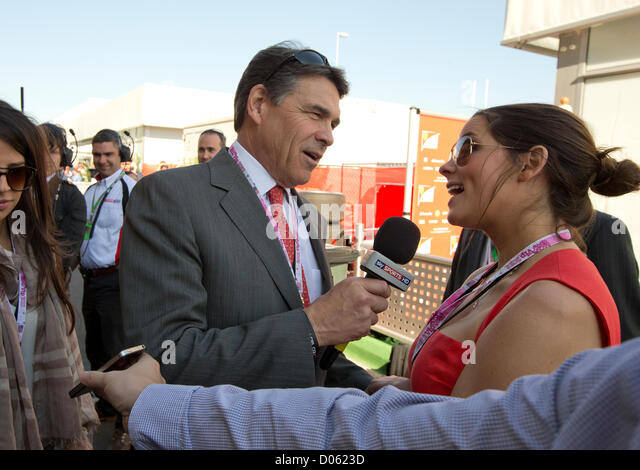 Texas Gov. Rick Perry interviews his daughter Sidney at the Circuit of the Americas before the F1 United States - Stock Image