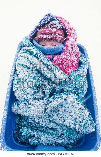 Alaska. Gustavus. Heacox house. Linnea Rain Lentfer in the snow on laundry day. - Stock Image