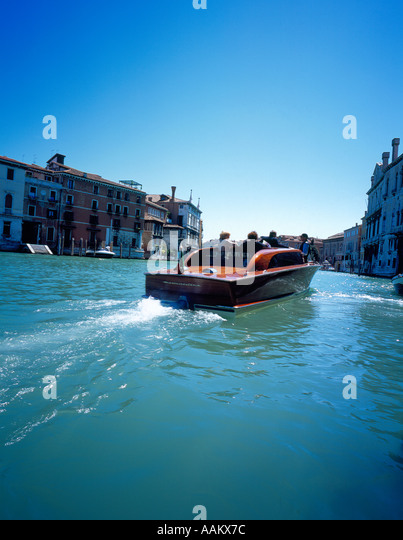 motor boat at Canal Grande Venice Italy Europe. Photo by Willy Matheisl - Stock Image