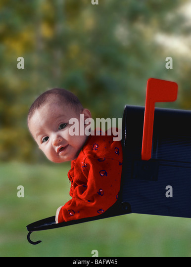 Baby in mailbox - Stock Image