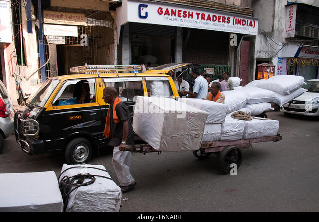 The image of Hand cart Puler in Mumbai, India - Stock Image