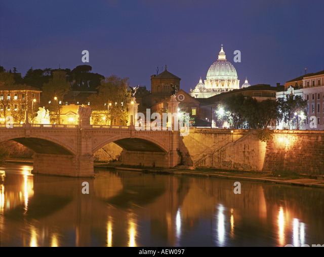 Italy Rome bridge over river Tiber St Peters Basilica at twilight  - Stock Image