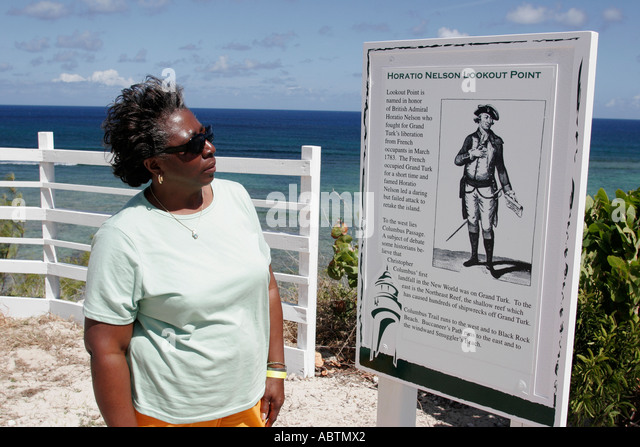 Turks and Caicos Grand Turk Horatio Nelson Lookout Point Black female tourist sign information - Stock Image