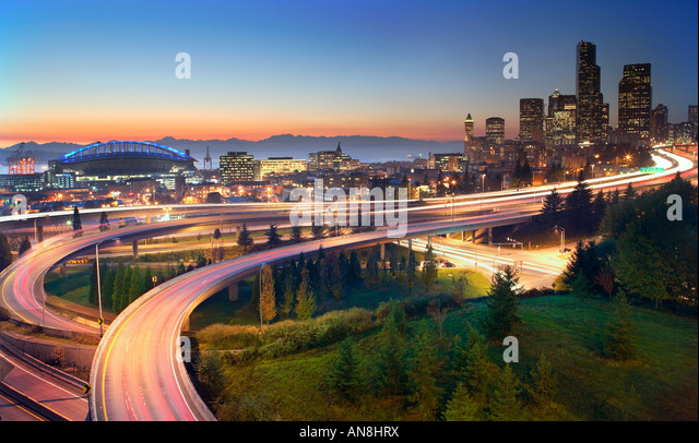 Freeways leading to downtown Seattle at sunset - Stock Image