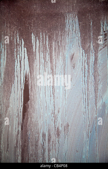 Textural effect of paint dripping on canvas - Stock Image