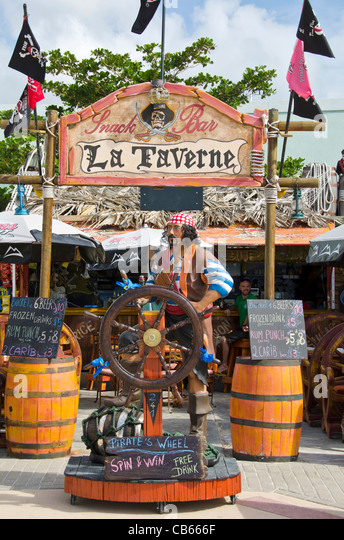 La Taverne bar with pirate statue on Front Street, Philipsburg, St Maarten - Stock Image