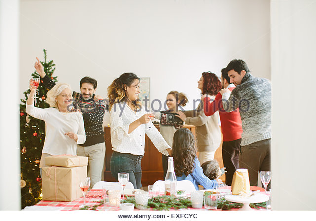 Family doing the conga at family Christmas party - Stock-Bilder