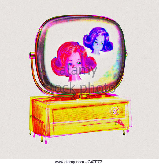 Kitsch vintage television  with fondue skewer set on screen - Stock Image