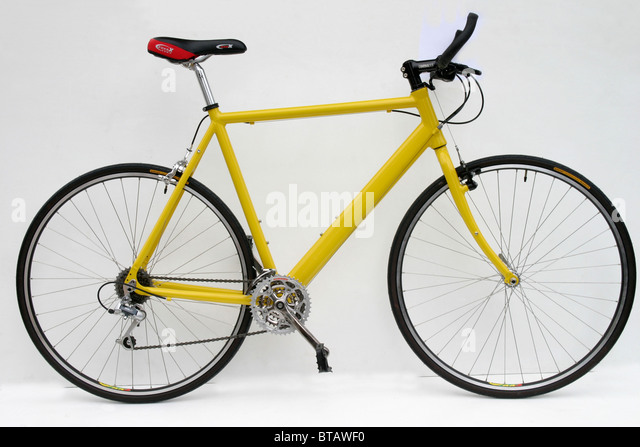 cutout of modern lightweight ally framed yellow hybrid roadster trekking fitness training style bike with 700c size - Stock Image