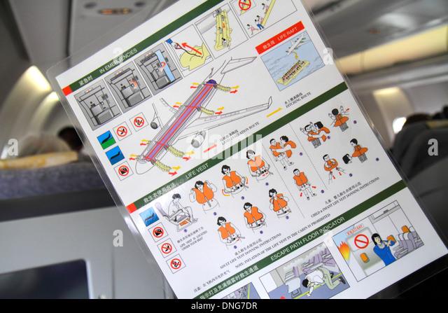 China Beijing Beijing Capital International Airport PEK Air China onboard cabin safety instructions folder card - Stock Image