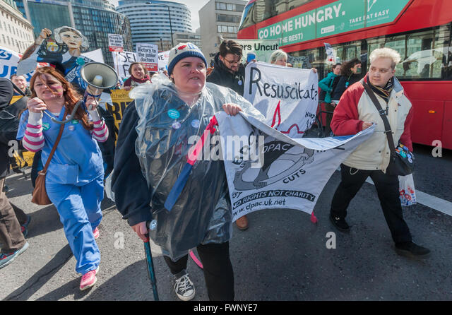 London, UK. 6th April, 2016. Paula Peters and the DPAC banner at the front of the march with the nurses across Westminster - Stock Image