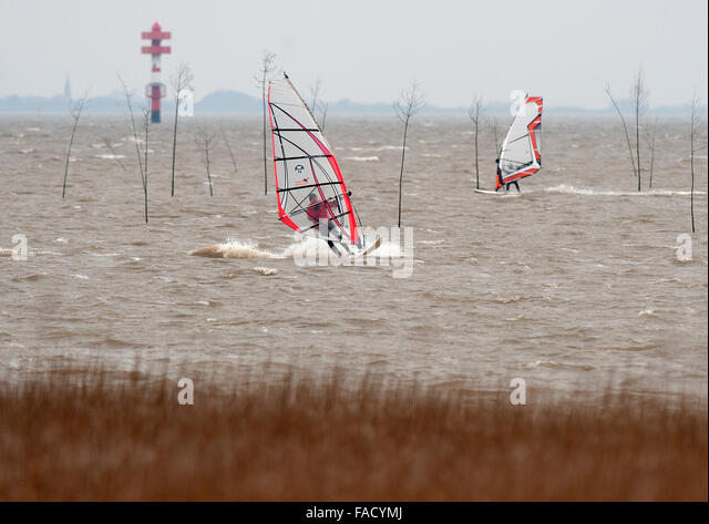 Windsurfers using the stormy gusts for a ride on the waves in the port of Wremen, Germany, 27 Photo: Ingo Wagner/dpa - Stock Image
