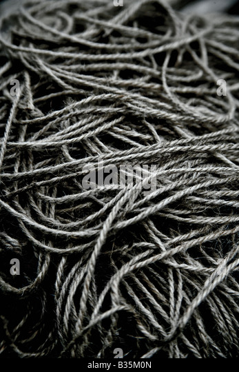 Black and white image of a pile of string - Stock Image
