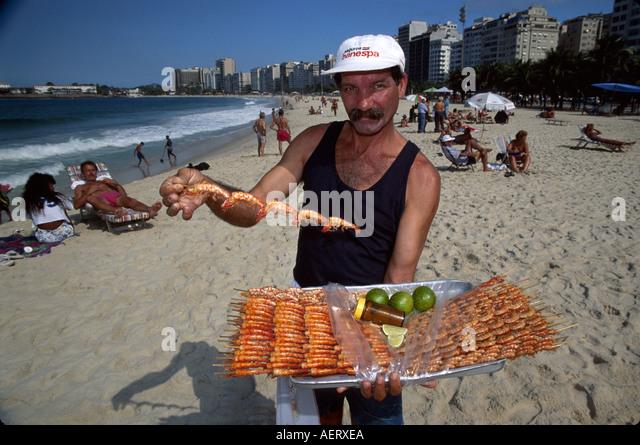 Brazil Rio de Janeiro Copacabana Beach shrimp vendor cariocas - Stock Image