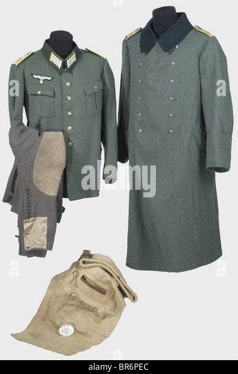A uniform ensemble for a field postal inspector., A field grey gabardine tunic with dark green collar (moth holes), - Stock Image