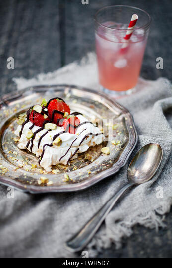 Homemade strawberry pavlova with chocolate and pistachios - Stock Image