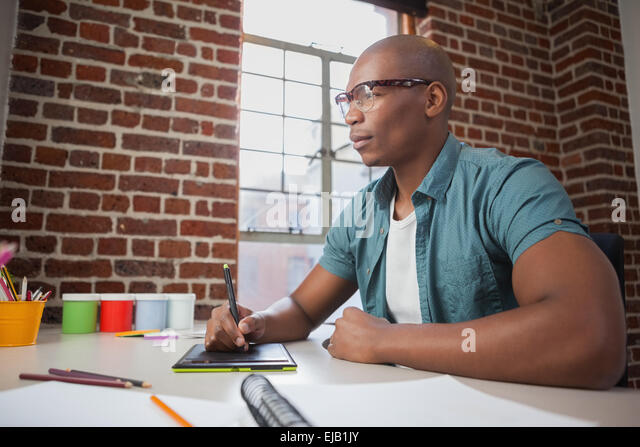 Designer sketching on graphics tablet - Stock Image