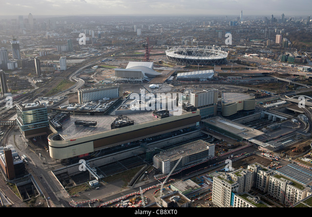 Westfield shopping center Stratford east London with Olympic site and stadium for 2012 Olympic games in background - Stock Image