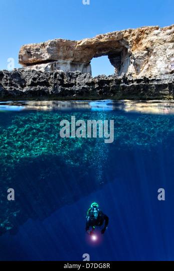 Scuba Diver at Azure Window, Gozo, Mediterranean Sea, Malta - Stock Image
