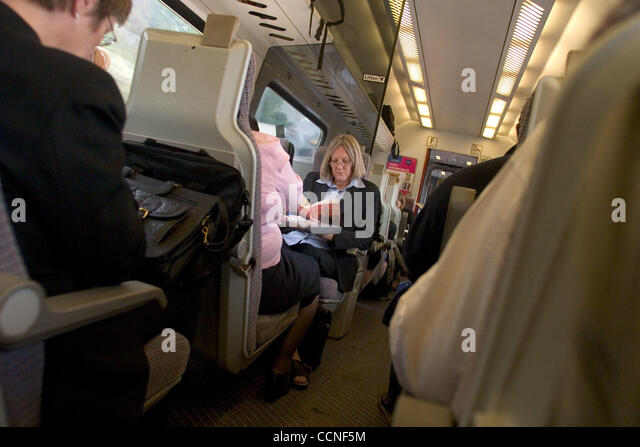 Oct 05, 2004; London, UK; Travellers and passengers on the train from London to Leeds enjoy reading books. Public - Stock Image