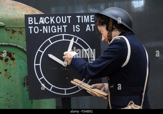 CAMBRIDGESHIRE, UK - OCTOBER 5TH 2015: An Air-raid Warden mannequin adjusting the blackout time at the Imperial - Stock Image