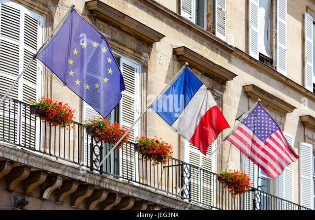 Paris, France - June 24, 2017 :  Three flags waving over Rivoli street in Paris : an europan flag, a french flag - Stock Image