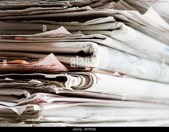 old newspapers in stack. Copy space - Stock Image
