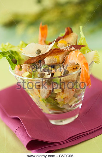 Avocado,shrimp,crouton and fried bacon salad - Stock Image