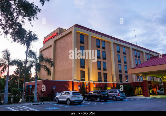 Florida Ellenton Hampton Inn hotel lodging Hampton by Hilton Hampton Inn building exterior sign parking lot car - Stock Image
