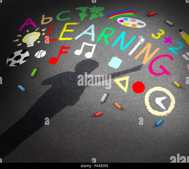 Child learning concept as the shadow of a young student on a schoolyard pavememt with chalk drawings of music math - Stock-Bilder