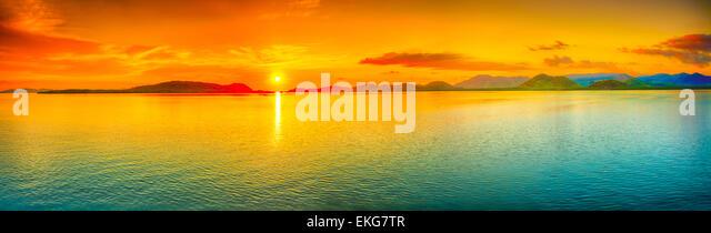Sunrise over the sea. Panorama - Stock Image
