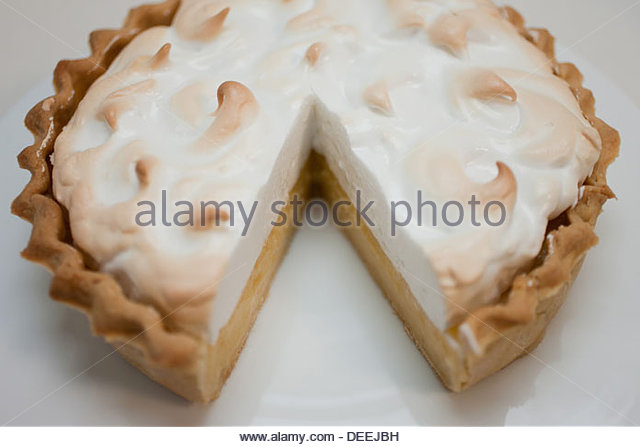 Cut of lemon meringue pie - Stock Image
