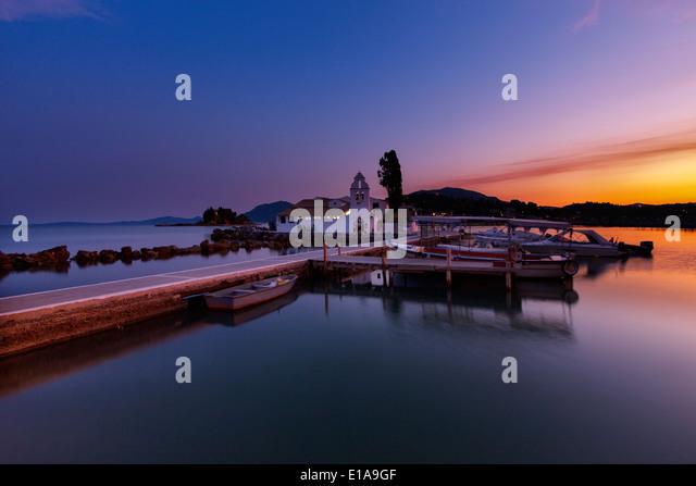 Pontikonisi monastery at sunset.Corfu island.Greece. - Stock Image