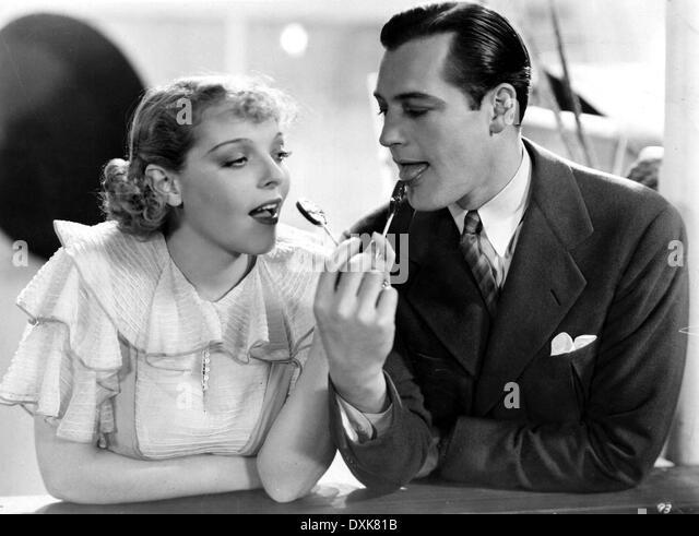 STOLEN SWEETS (US1934) SALLY BLANE, CHARLES STARRETT LOLLIPO - Stock Image